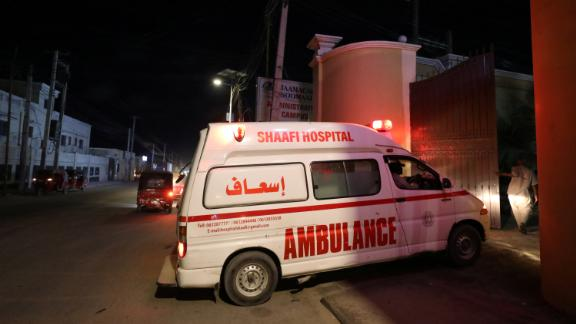 An ambulance carrying a victim from an attack by Al-Shabaab gunmen on a hotel near the presidential residence arrives at the Shaafi hospital in Mogadishu.
