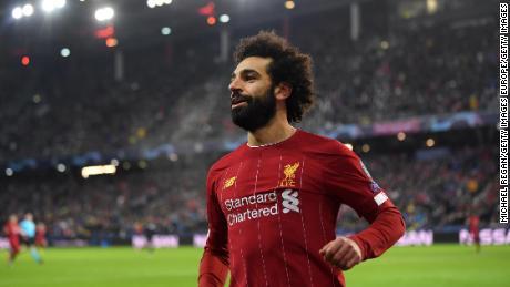 Salah celebrates after scoring Liverpool's second goal.