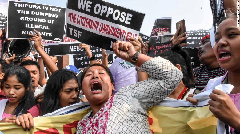 Demonstrators shout slogans as they hold placards to protest against the government's Citizenship Amendment Bill in Agartala in India's northeast state of Tripura.