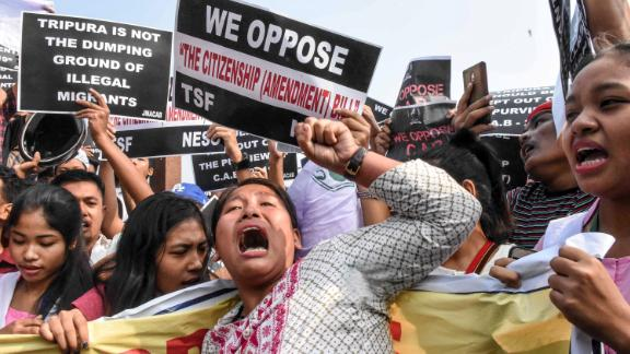 Demonstrators shout slogans during a shutdown called by the North East Students' Organization in Agartala, India, on December 10. It was hours after lawmakers approved the government's new citizenship bill.
