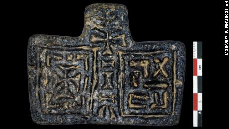 "Archeologists found this stone pendant, inscribed with the word ""venerable"" in ancient Ethiopic or Ge'ez with a cross on the left. They said it was ""clearly important in terms of ancient Christian iconography."""
