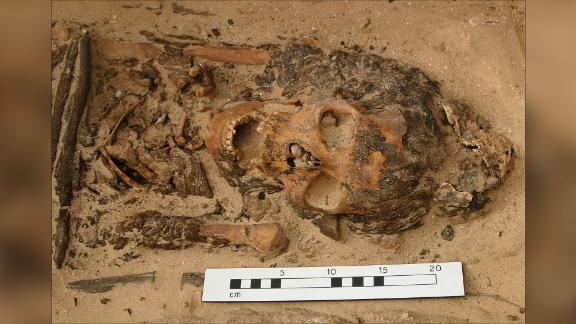 An ancient Egyptian head cone was first found with the remains of a young woman buried in one of Amarna's graves.