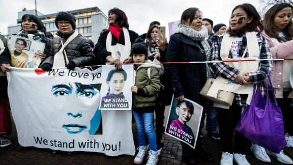 Protesters in support of Myanmar's State Counsellor Aung San Suu Kyi stand in front of the Peace Palace of The Hague.