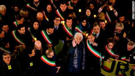 Liliana Segre, an 89-year-old Auschwitz survivor, center, with Milan's mayor Giuseppe Sala during an anti-racism demonstration in northern Italy.