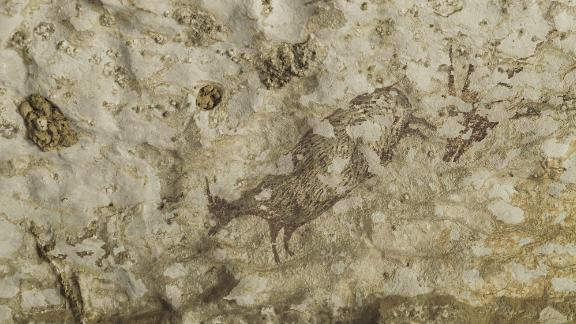Part of the scene depicted in the world's oldest cave art, which shows half-animal, half-human hybrids hunting pigs and buffalo.