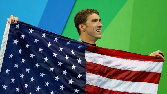 RIO DE JANEIRO, BRAZIL - AUGUST 13:  Gold medalist Michael Phelps of the United States poses during the medal ceremony for the Men's 4 x 100m Medley Relay Final on Day 8 of the Rio 2016 Olympic Games at the Olympic Aquatics Stadium on August 13, 2016 in Rio de Janeiro, Brazil.  (Photo by Al Bello/Getty Images)