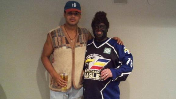 Akim Aliu with Eagles equipment manager Tony Deynzer at a 2011 Halloween party.