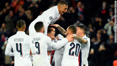 Edinson Cavani (C) is mobbed by his teammates after scoring the fifth goal in the 5-0 win over Galatasaray.