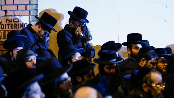 Orthodox Jewish men mourn during the funeral service of Mindy Ferencz, who who was killed in a kosher market that was the site of a gunbattle in Jersey City.