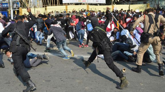 Security personnel use batons to disperse students protesting against CAB in Guwahati on December 11.