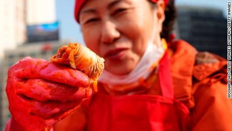 SEOUL, SOUTH KOREA - NOVEMBER 03:  People make kimchi, a traditional pungent vegetable dish, which is donated to the poor in preparation for winter on November 3, 2017 in Seoul, South Korea.  (Photo by Woohae Cho/Getty Images)