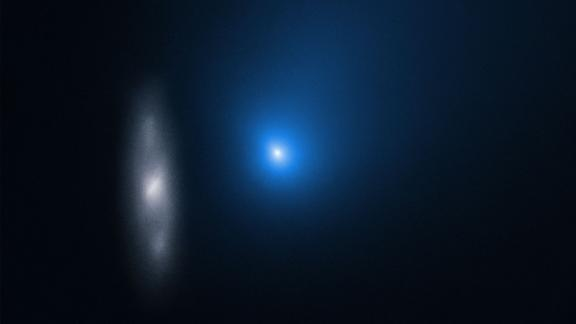 This image from November 16 shows the comet in front of a distant background spiral galaxy.