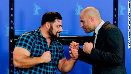 "James Wilks (right) poses with German strongman Patrik Baboumian (left) who is a protagonist in ""The Game Changers"" and speaks of his improved performance since transitioning to a plant-based diet."