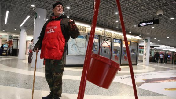 A Salvation Army volunteer bell ringer solicits donations at the Powell Street Bay Area Rapid Transit (BART) station on December 3, 2019, in San Francisco.