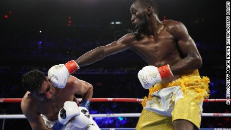Terence Crawford punches Amir Khan during their WBO welterweight title fight at Madison Square Garden on April 20, 2019 in New York City.