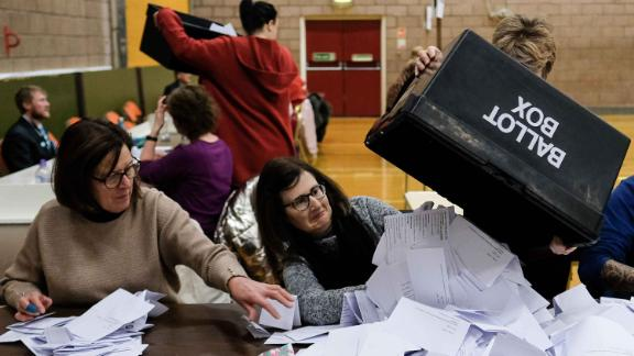 HARTLEPOOL, ENGLAND  - DECEMBER 12: Volunteers begin to count ballot papers during the general election count at Mill Bank leisure centre on December 12, 2019 in Hartlepool, England. The current Conservative Prime Minister Boris Johnson called the first UK winter election for nearly a century in an attempt to gain a working majority to break the parliamentary deadlock over Brexit. The election results from across the country are being counted overnight and an overall result is expected in the early hours of Friday morning. (Photo by Ian Forsyth/Getty Images)