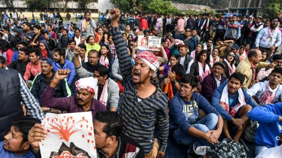Demonstrators shout slogans during a protest against the government