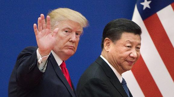 US President Donald Trump (L) and China's President Xi Jinping leave a business leaders event at the Great Hall of the People in Beijing on November 9, 2017.