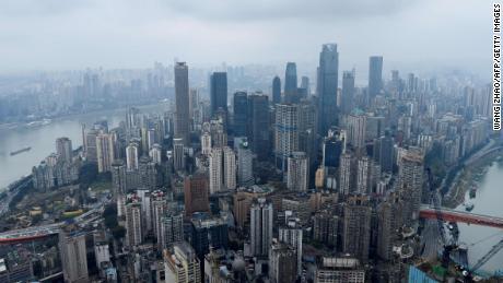 This picture taken on March 22, 2019 shows a skyline of Chongqing from the top of Raffles City Chongqing under construction in southwest China's Chongqing Municipality. - In many Chinese cities, government restrictions have cooled formerly feverish property markets, but in the southwestern city of Chongqing, construction is booming and sales soaring as investors rush in. (Photo by WANG ZHAO / AFP) / TO GO WITH CHINA-PROPERTY-URBAN-PLANNING by Elizabeth LAW (Photo credit should read WANG ZHAO/AFP via Getty Images)
