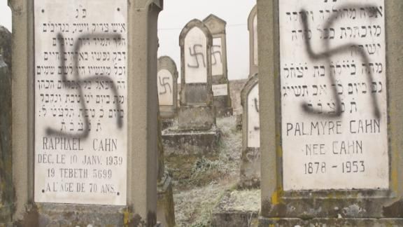 Image for 100 Jewish graves were desecrated in France. A search for the websites that fueled the hate led to the US