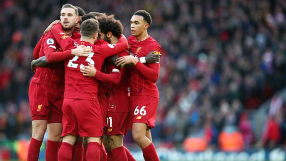 Liverpool players celebrate Mo Salah's winning goal against Watford.