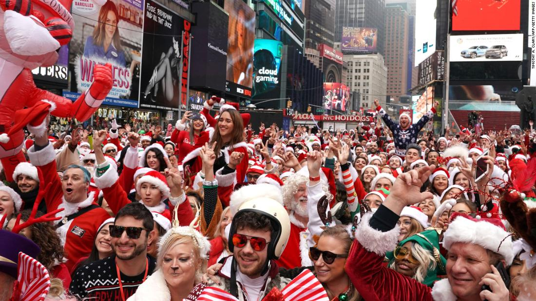 Thousands of Santa Clauses flood the streets of New York City. Welcome to SantaCon
