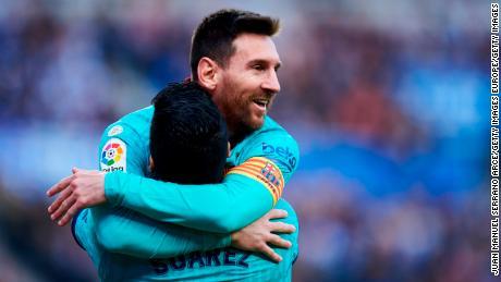 Luis Suarez celebrates his goal with teammate Lionel Messi.