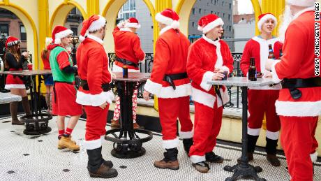 SantaCon revelers enjoy a drink at Celtic Pub in New York on December 14, 2019.