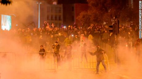 Lebanese demonstrators hurl rocks at riot police on Saturday night.