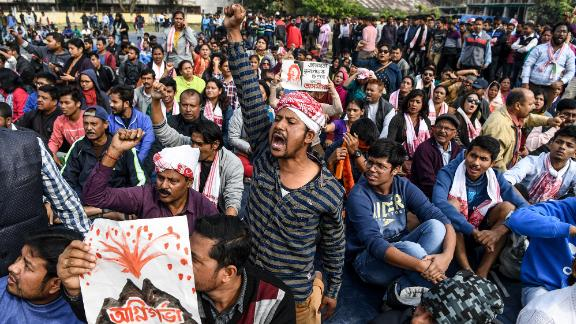 Demonstrators shout slogans during a protest in Guwahati on Friday, December 13.