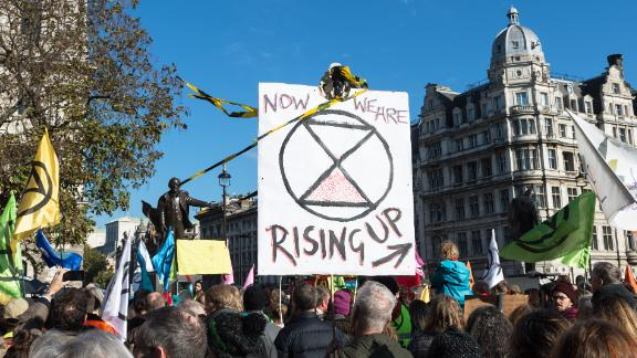 """Hundreds of activists in Parliament Square for XR's """"declaration of rebellion"""" in 2018."""