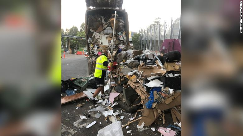City council workers and trash collectors emptied the 30-ton garbage truck to find the missing rings.