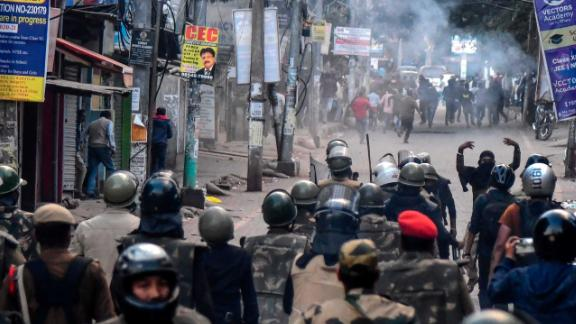 Police fire tear gas during a protest in Guwahati on Thursday, December 12.