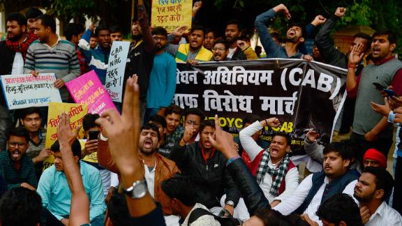 Students and activists protest outside the Allahabad University campus in Allahabad, India, on Monday, December 16.