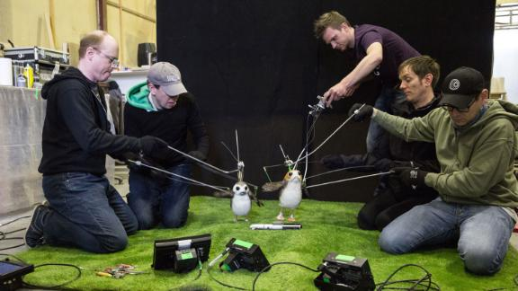 Two puppeteers, including Brian Herring and Dave Chapman on the right, were assigned to each porg.