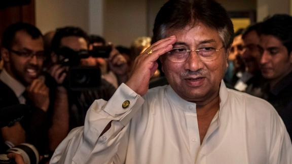 DUBAI, UAE - MARCH 24: Former Pakistani president, Pervez Musharraf salutes as he arrives to brief media and supporters during a press conference ahead of his return, at the Dubai APML party headquarters on March 24, 2013 in Dubai United Arab Emirates. The former Pakistani president and military ruler is returning to Pakistan after 4 years of self-imposed exile to participate in historic elections in May. Mr Musharraf has been granted protective bail in several cases, including conspiracy to murder which has paved his way allowing for his return. (Photo by Daniel Berehulak/Getty Images)