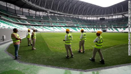Workers is seen inside the stadium during a stadium tour ahead of the FIFA World Cup Qatar 2022 at Education City Stadium on December 15.