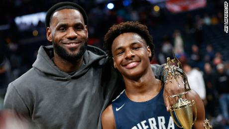 LeBron James, left, poses with his son, LeBron James Jr., also known as Bronny, after Sierra Canyon beat James' alma mater, St. Vincent-St. Mary, on December 14 in Columbus, Ohio.