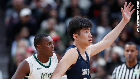 Harold Yu of Sierra Canyon posts up against Marcus Johnson of St. Vincent-St. Mary.