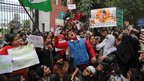 Students from Jamia Millia Islamia, a university in New Delhi, shout slogans during a protest on Tuesday, December 17.