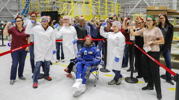 Boeing female workers surrounded Rosie the test dummy to celebrate.