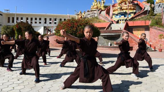 Nepali Buddhist nuns practise kung fu at the Amitabha Drukpa Nunnery on the outskirts of Kathmandu.