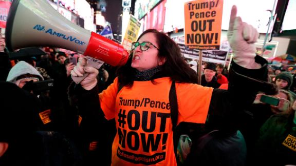 """NEW YORK, NEW YORK - DECEMBER 17: Demonstrators join national impeachment demonstrations to demand an end to Donald Trump's presidency named """"Nobody Is Above The Law"""" Rally - NYC at Times Square on December 17, 2019 in New York City. (Photo by John Lamparski/Getty Images for MoveOn.org)"""