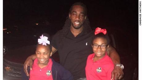 Ryan Matthews with his two daughters, Chassidy (left) and Re'yan (right) before heading to a school book fair