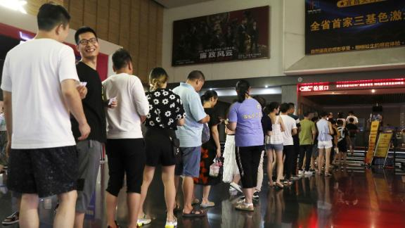 """Chinese filmgoers wait inside a cinema to watch Chinese animated film """"Ne Zha"""" in Yichang city, central China"""