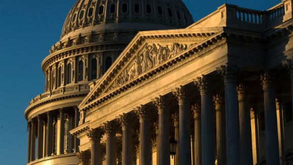 The U.S. Capitol building is illuminated by the rising sun, Wednesday, Dec. 18, 2019, on Capitol Hill in Washington. President Donald Trump is on the cusp of being impeached by the House, with a historic debate set Wednesday on charges that he abused his power and obstructed Congress ahead of votes that will leave a defining mark on his tenure at the White House. (AP Photo/Matt Rourke)