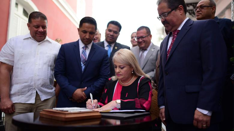 Gov. Wanda Vazquez signs a bill into law that keeps cockfighting alive on the island despite a federal ban.
