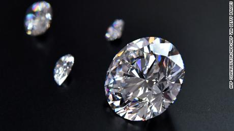 A view of the main 51.38-carat round-cut diamond, the Dynasty, among other gems from Russian diamond miner Alrosas Dynasty polished diamonds collection in Moscow on August 3, 2017. The collection of five polished stones was manufactured from a 179-carat Romanovs rough diamond, extracted at the companys Nyurbinskaya kimberlite pipe in Russia's far northeast region of Yakutia in 2015. Alrosa plans to sell the whole collection in one set at a special online auction in November with the starting price not less than $10 million, according to the companys CEO Ivanov. / AFP PHOTO / Yuri KADOBNOV        (Photo credit should read YURI KADOBNOV/AFP via Getty Images)