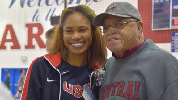 T.C. Williams alumna Tynita Butts with Boone in 2019. Butts competed in the IAAF World Athletics Championships this fall.