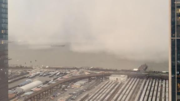 A snow squall moves across the Hudson River towards Manhattan on December 18, 2019.
